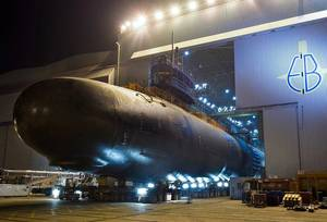 File photo: A U.S. Navy submarine is rolled out of an indoor shipyard facility at General Dynamics Electric Boat in Groton, Conn. (U.S. Navy photo courtesy of General Dynamics)