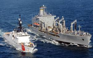 A patrol boat manned by members of Port Security Unit 311 deployed to Joint Task Force-Guantanamo Bay, Cuba, escorts the Coast Guard Cutter Bertholf as it sails into Naval Base Guantanamo Bay.  The Coast Guard Cutter Waesche conducts at-sea refueling operations.  The Alameda-based cutter is named in honor of former Coast Guard Commandant Adm. Russell Waesche.  (U.S. Coast Guard photo by Petty Officer 1st Class Matthew Roache)