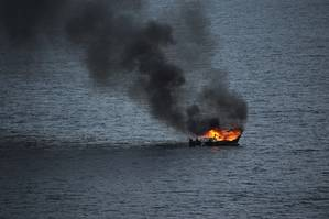 A fire destroys a fishing boat in the Atlantic Ocean about 90 miles off the coast of Florida. (U.S. Navy photo by William Spears)