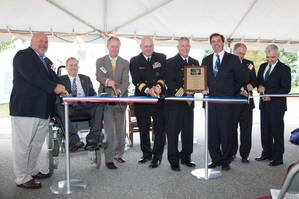 Cutting the ribbon, from left, Dominic Galluci, P&S Construction; RI Congressman James Langevin; RI Governor Lincoln Chafee; Rear Adm. Michael Jabaley, commander, NUWC; Capt. Todd Cramer, commander, NUWC Division Newport; Mark Rodrigues, head NUWCs Platform and Payload Integration Department; Blair Decker, General Dynamics/Electric Boat; and RI Senator Jack Reed.