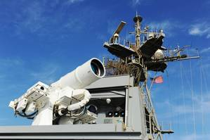 The Afloat Forward Staging Base (Interim) USS Ponce (ASB(I) 15) conducts an operational demonstration of the Office of Naval Research (ONR)-sponsored Laser Weapon System (LaWS) while deployed to the Arabian Gulf. (U.S. Navy photo by John F. Williams) Caption