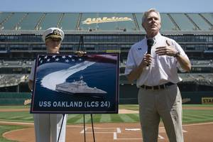 Secretary of the Navy (SECNAV) Ray Mabus announces the name of the Independence-class littoral combat ship LCS 24 as USS Oakland during a major league baseball game between the Oakland Athletics and Los Angeles Dodgers. (U.S. Navy photo by Armando Gonzales)