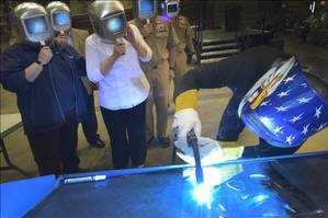 A welder authenticates the keel by welding the initials of the ships sponsor, Sharla D. Tester, onto the keel plate of the U.S. Navys fifteenth Littoral Combat Ship (LCS), the future USS Billings (LCS 15), in a ceremony held at Fincantieri Marinette Marine in Marinette, Wisconsin. The Keel Laying is the formal recognition of the start of the ship and module construction process. (U.S. Navy photo by Lockheed Martin)