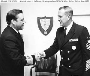 Adm. James L. Holloway III congratulates Master Chief Petty Officer of the Navy Robert Walker, June 1975. (U.S. Navy photo)