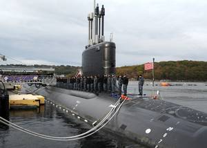 Sailors assigned to the Virginia-class attack submarine Pre-Commissioning Unit (PCU) Illinois (SSN 786) salute after bringing the ship to life during a rehearsal for the submarines commissioning ceremony. Illinois is the U.S. Navys 13th Virginia-Class attack submarine and the fourth U.S. Navy ship named for the state of Illinois. (U.S. Navy photo by Darryl I. Wood)