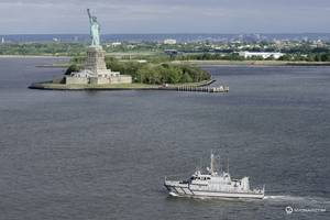 A USNA Yard Patrol Craft passes the Statue of Liberty as part of the parade of ships, kicking off Fleet Week New York 2015. (Photo courtesy nyonair.com)