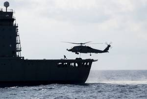 "SOUTH CHINA SEA (May 7, 2019) An MH-60R Sea Hawk helicopter assigned to the ""Easyriders"" of Helicopter Maritime Strike Squadron (HSM) 37, Detachment 1, picks up pallets from the Military Sealift Command fleet replenishment oiler USNS Guadalupe (T-AO 200) during a replenishment-at-sea with the Arleigh Burke-class guided-missile destroyer USS Preble (DDG 88). Preble is deployed to the U.S 7th Fleet area of operations in support of security and stability in the Indo-Pacific region. (U.S. Navy photo"