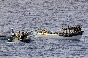 HMAS Melbournes boarding party intercepts a suspected pirate boat. (Photo: ABIS Jayson Tufrey)