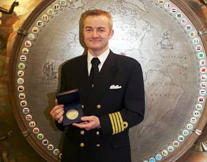 2014 IMO Award for Exceptional Bravery at Sea: Captain Andreas Kristensen with the medal he and his crew of the Britannia Seaways received. (Photo: IMO)