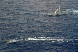 HMAS Newcastle tracks a dhow on July 3, 2014 off the East Coast of Africa and from which it siezed 138 kg of heroin. (Photo: Brenton Freind)