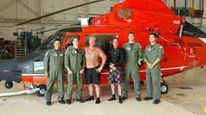 A Coast Guard Air Station Corpus Christi MH-65 Dolphin helicopter aircrew stands with two rescued divers after they were located and rescued Saturday, June 27. (U.S. Coast Guard photo)