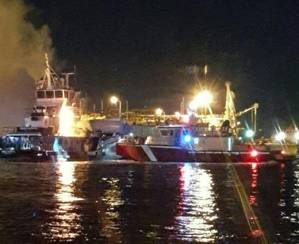 Houston Marine Fire Department boat on scene after a tug boat that was moored caught fire around 2 a.m., Feb. 26, 2016. U.S. Coast Guard Station Houston boat crews established a safety zone to assist in firefighting efforts. (USCG photo by Joseph Mccune)