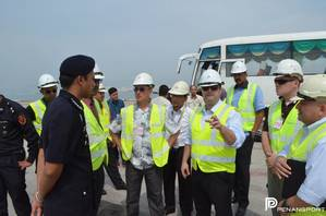 Lt. Cmdr. Carlos Gavilanes (Far Right/Light Blue Shirt), Lt. Cmdr. Kevin Beaudoin (Brown Shirt), Lt. Alejandro Collazo (Light Blue Shirt/Hand Gesture) and Mr. Tivo Romero (Aloha Shirt). (Photo courtesy Penang Port Sdn Bhd.)
