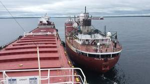 Lightering operations continue while the vessel Roger Blough is anchored in Waiska Bay to transfer its cargo to the Philip R. Clarke and Arthur M. Anderson. (Photo courtesy of Ken Gerasimos, Key Lakes Shipping)
