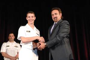 Northrop Grumman Corporation presented the 2014 Elmer A. Sperry Junior Navigator of the Year Award to Midshipman Robert Francisco Yerkes-Medina in ceremonies at the U.S. Naval Academy. The award was presented by Jeff Holloway (right), director of the companys Charlottesville, Virginia, campus and an academy graduate. (Photo courtesy of Northrop Grumman)