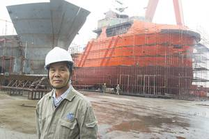 Xin Yue Feng Shipyard's Chairman Luo Chaoneng with a pair of AHTs.