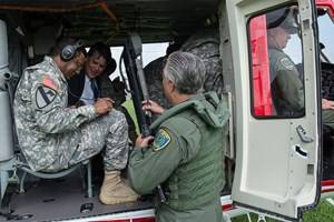 Lt. Gen. Bostick prepares for liftoff in a city of Houston helicopter used in patrols over the Houston Ship Channel Security District, which includes PHAs terminal facilities.