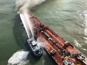 A Corpus Christi Fire Department vessel extinguishes a fire on board Buster Bouchard/B. No. 255 approximately three miles from the Port Aransas, Texas, jetties on October 20, 2017. (Photo: U.S. Coast Guard)
