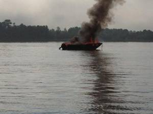 A 17-foot pleasure craft is fully engulfed in flames near Sugar Island on the St. Marys River, Aug. 29, 2013. U.S. Coast Guard photo by Petty Officer 1st Class Joseph Kerr, executive petty officer of Station Sault Ste. Marie.