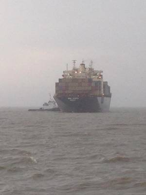 The container ship MSC Kyoto heaves-to aground outside the Mobile Ship Channel, April 7, 2014. The MSC Kyoto reportedly experienced a steering failure. (USCG photo)
