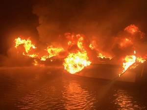 A 36-foot fishing vessel ablaze near Dauphin Island, Ala. (U.S. Coast Guard photo)
