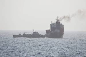 Wila, a merchant vessel in international waters en-route to the UAE port of Khor Fakkan, in the Gulf of Oman, was boarded by armed Iranian personnel from both an Iranian Sea King helicopter and the Iranian auxiliary vessel Hendijan (1401). (U.S. Navy photo)