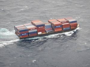 Barge container ship, Columbia Elizabeth, is towed to Port of Palm Beach, Dec. 6, 2015. While enroute to Puerto Rico, several cargo containers fell overboard off the coast of Port Canaveral, Fla. (U.S. Coast Guard photo)