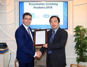 Nick Brown presenting the AiP to Dr Chen Gang at Posidonia  (Photo: Lloyd's Register)