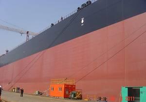 Comparison Size Man & Ship:Photo Credit Wiki CCL Superfast1111