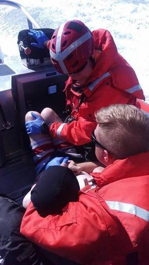 A Coast Guard Station Grays Harbor crew aboard a 29-foot Response Boat-Small II rescues a man who was swept out to sea while wading in the water near the Grays Harbor north jetty at Ocean Shores, Wash., July 17, 2016.The man was taken back to Station Grays Harbor where he was met by local emergency medical services for further medical care. U.S. Coast Guard photo by Coast Guard Station Grays Harbor.