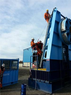 Aquatics offshore team using harnesses and ladders to assemble modular reel drive system Photo Aquatic