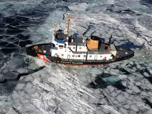 The Coast Guard Cutter Thunder Bay breaks ice in the Straits of Mackinac between Lake Huron and Lake Michigan. (U.S. Coast Guard photo)