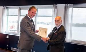 Damen CEO René Berkvens (left) receives a CEMT award from CEMT Chairman Trevor Blakeley (Photo: Damen)
