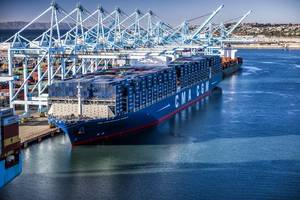 File Image: A CMA CGM boxship condusting cargo operations alongside (CREDIT: Marad)