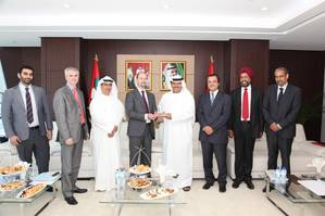 VP Global LNG receiving a memento from Khamis Juma Buamim, Chairman of Drydocks World & Maritime World