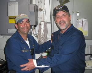 Capt. Phillips & Cmdr. Frank Castellano: Photo credit USN