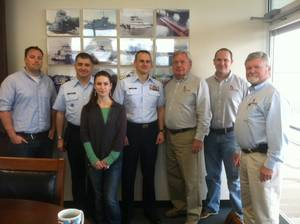 Pictured above are, from left to right, Mike Capitain, Naval Architect, Cdr. Gooding, Jackie Ellis, Designer, Capt.. Nadeau, Ed Shearer, Principal Naval Architect, Christian Olavesen, Naval Architect and Ron Sikora, Senior Designer. Not pictured was Joshua Sebastian, Engineering Manager and Jo Ann Pitzer, Office manager.