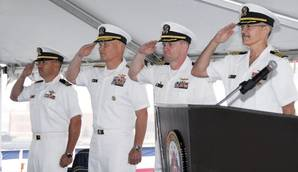 (Left to right) Navy Lt. Harlan Kimball, Comfort chaplain; Navy Rear Adm. Mark H. Buzby, commander, Military Sealift Command; Navy Capt. David K. Weiss, U.S. Navy Medical Corps; and Navy Capt. Kevin J. Knoop, commanding offer, Medical Treatment Facility, USNS Comfort, participate in Military Sealift Command hospital ship USNS Comforts Medical Treatment Facility change of command ceremony May 25 in Baltimore.