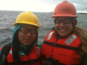 Scholarship winners Ariel Zhou (left) and Caiti Campbell (right) aboard Crolweys tug, Guardsman