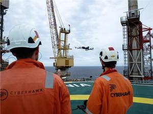 Cyberhawk team operating a drone offshore Photo Cyberhawk