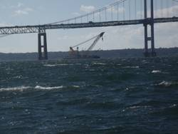 Donjon's Chesapeake 1,000 heavy lift crane works to salvage a sunken barge under the Newport Pell Bridge in Newport, Rhode Island last November.