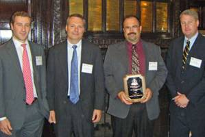 Gladding-Hearn Shipbuilding officials accept 2009 Improvement in Safety Award from the Shipbuilders Council of America in April (left to right): Ian Bennitt, SCA manager of government affairs, Peter Duclos, Gladding-Hearn president, Paul Simons, Gladding-Hearn's safety and compliance coordinator, and Matt Paxton, SCA president.