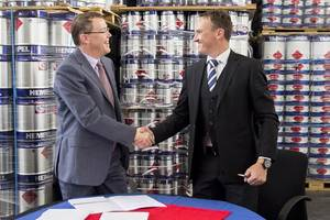 From left to right: Kim Junge Andersen (Group Executive Vice President and CFO) and Johann Geldenhuis (TCMCs General Manager) shaking hands after the deal was signed. (Photo: Hempel)