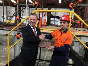 Minister Pynes' signature was welded into a plate that was in turn welded into the hull by the Minister, with assistance from one of Austal's newest Apprentice Fabricators, Ricardo De Oliveira. (Image: Austal)