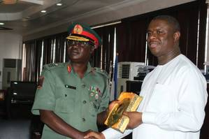 The Director General of the Nigerian Maritime Administration and Safety Agency (NIMASA), Dr. Dakuku Peterside receiving a plaque from the General Officer Commanding (GOC) 81 Division of the Nigerian Army, Major General Peter John Dauke when the GOC paid a courtesy visit to the NIMASA DG at the Agency's headquarters in Lagos. (Photo: NIMASA)