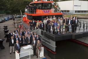Attendees pose for a photo with OWS' new Damen FCS 2008 vessel, Offshore Waddenzee, during the christening ceremony at Damen Oranjewerf Amsterdam, on August 22 (Photo: Damen)