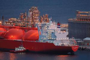 LNG Helper: Gas carrier Arctic Princess helped by a tug at Melkoya, Norway.