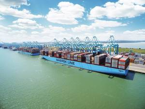 A Maersk boxship alongside working cargo. (File Image: Maersk)