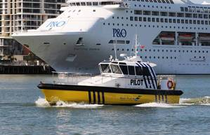 "Pilot launch ""MALU MAI"" with Carnival Australia cruise ship Pacific Dawn in the background. Photo credit: Australian Reef Pilots Pty Ltd."