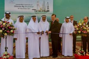 HE Sheikh Saud Bin Khalid Al Qasimi (center) cuts the ribbon for the NDC Shuwehat rig alongside Lamprell CEO Jim Moffat (right) and NDC Chief Executive Officer Abdalla Saeed Al Suwaidi (left)